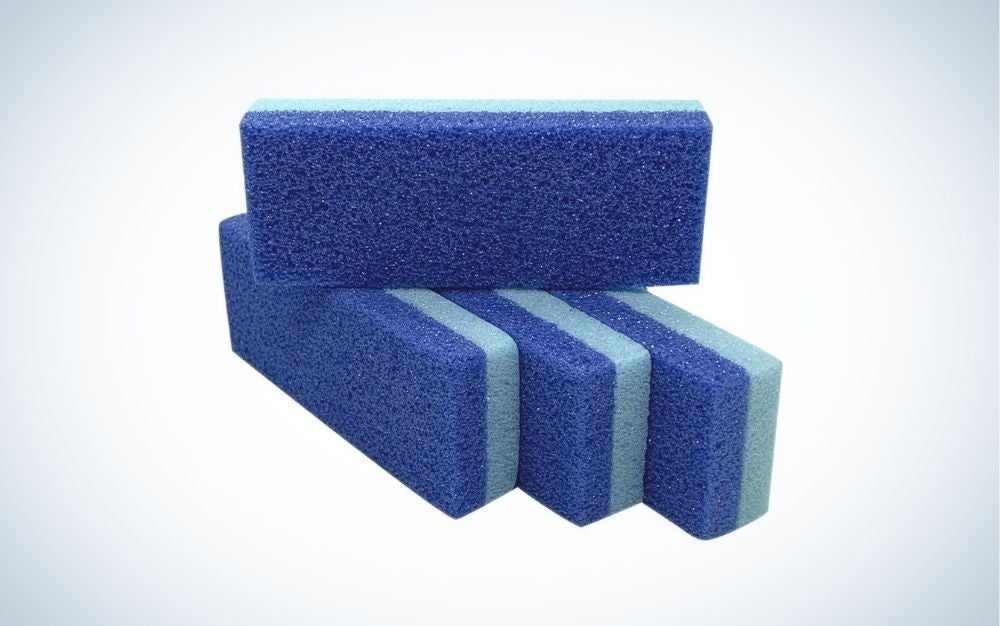 Four blue and light blue foot pumice stone for removing hard skin and callus on feet.