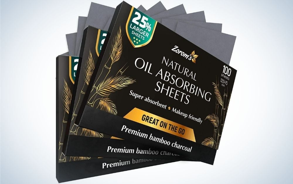 Three black and gold packing with bamboo sheets and with lettering natural oil absorbing sheets written on it.