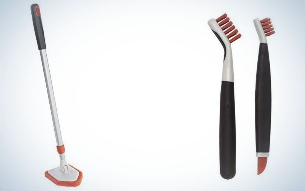 two tile scrubbers with black tail and orange and white brush, and one grips extendable tub with an enhanced shape.