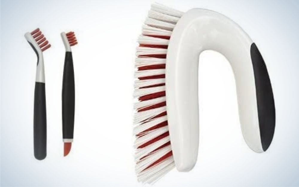 An arched household scrub with strong eraser and two clean brush set beside each other.