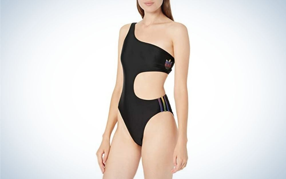 A woman wearing a bathing suit with a style opened in the belly and the adidas logo into it.