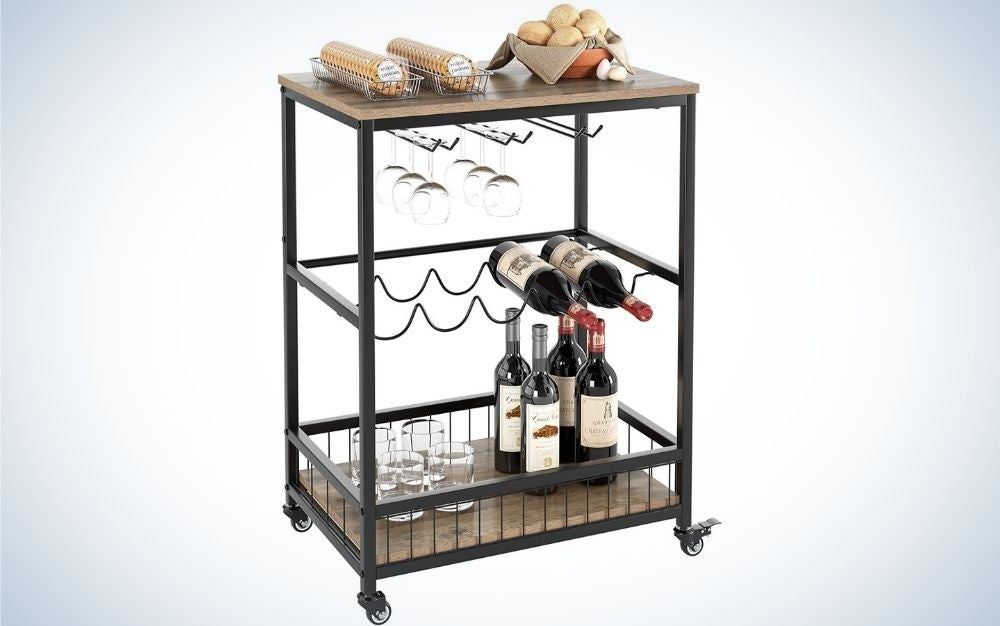 A beverage cart with wine rack and glass holder, rolling serving cart with lockable wheels with wood and metal frame and with a rustic brown in the end of the bar cart,