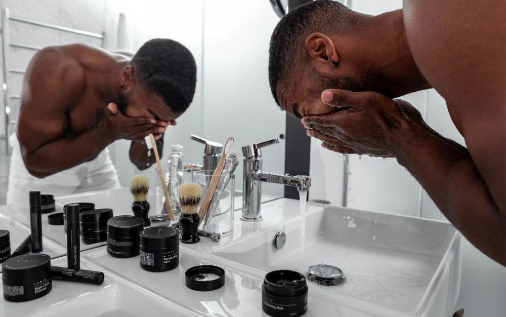 Man washing his face on a sink