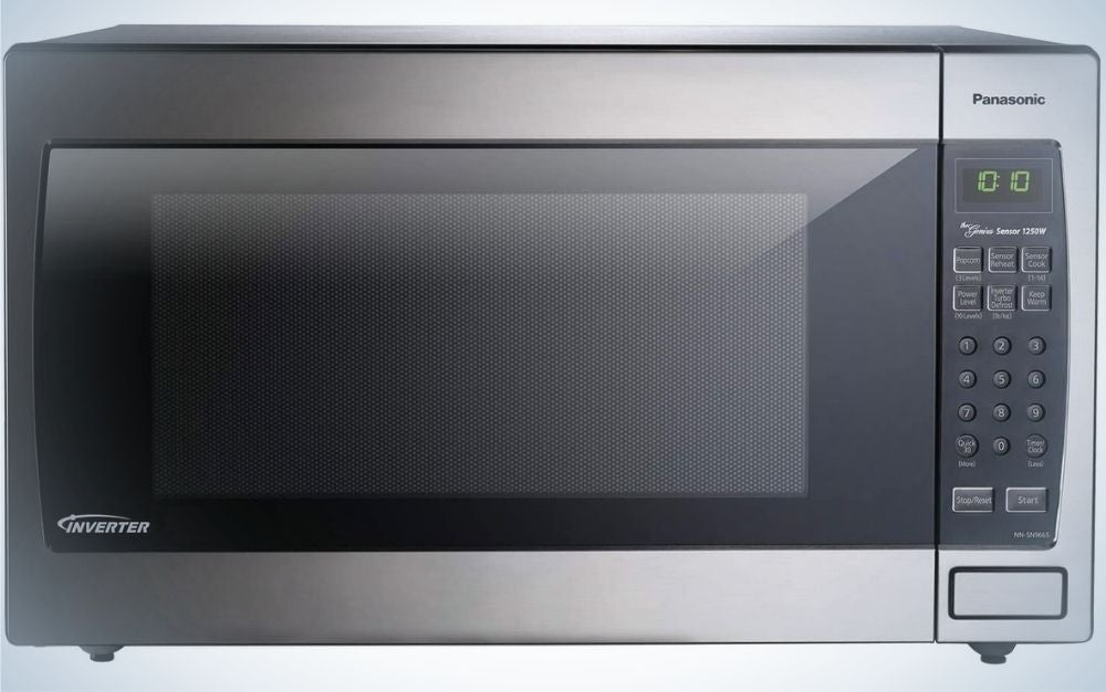 An modern black and dark silver Inverter microwave with buttons and number aside of it.
