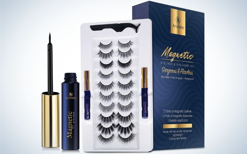 A blue box of eyelashes and a set of open eyelashes product with different shapes and a blue and gold mascara beside them.