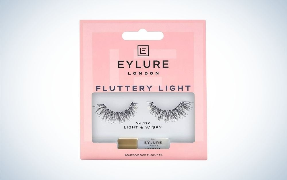 A pink box with lettering EYLURE, and with a pair of false eyelashes into it.