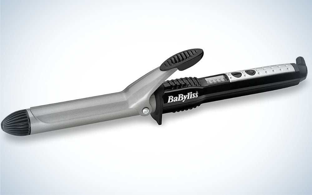 A hair curler with a black holder and a silver head where to put the hair an to make them curly.