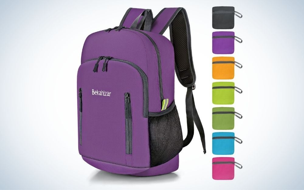 Purple, foldable women's backpack with multiple pockets