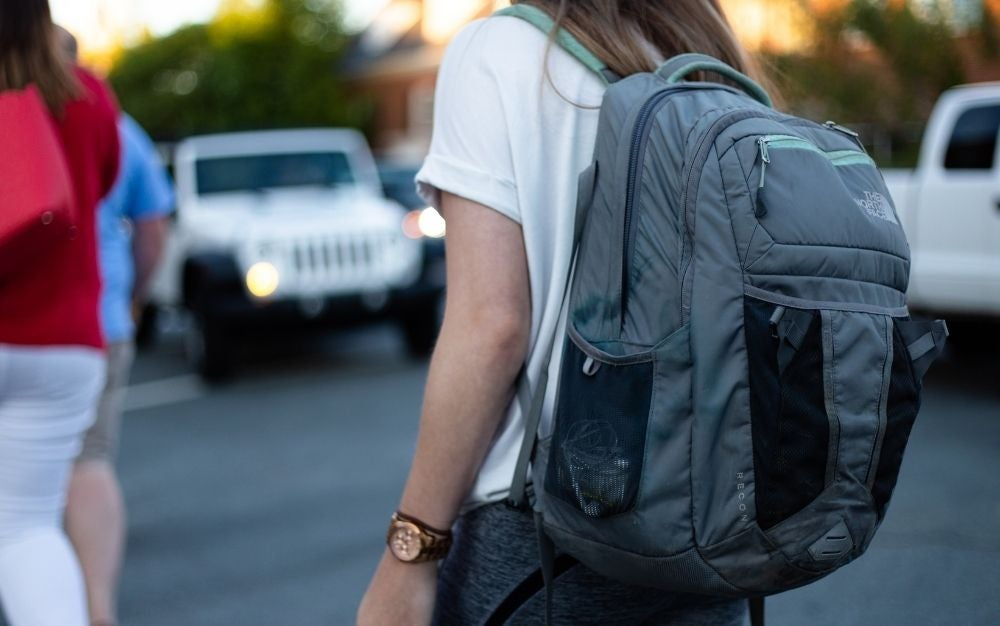 Person using gray backpack