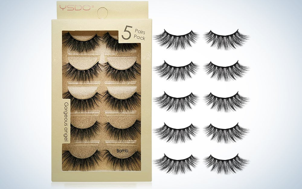 five pairs of false eyelashes both in and out of a gold box