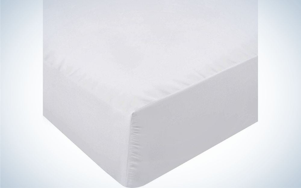 A piece to lay on a light gray corner made of polyester material.