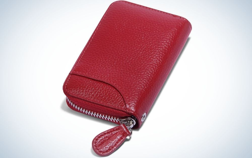 A wallet for women in bright cherry color and with a holder in the shape of a thin belt.