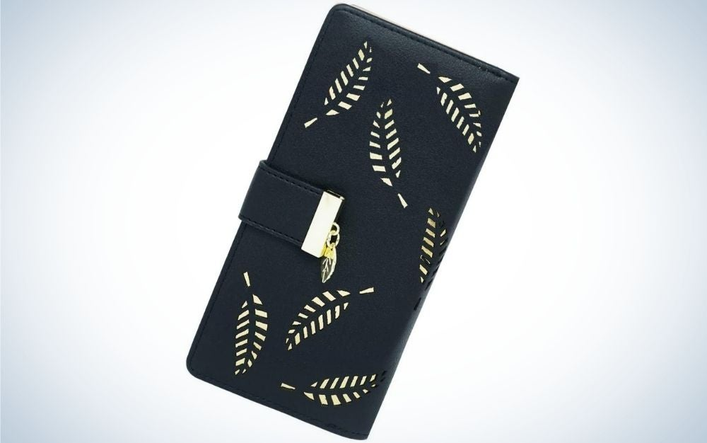 A wide portfolio for women in the shape of a black rectangle all with some beige leaf shapes.