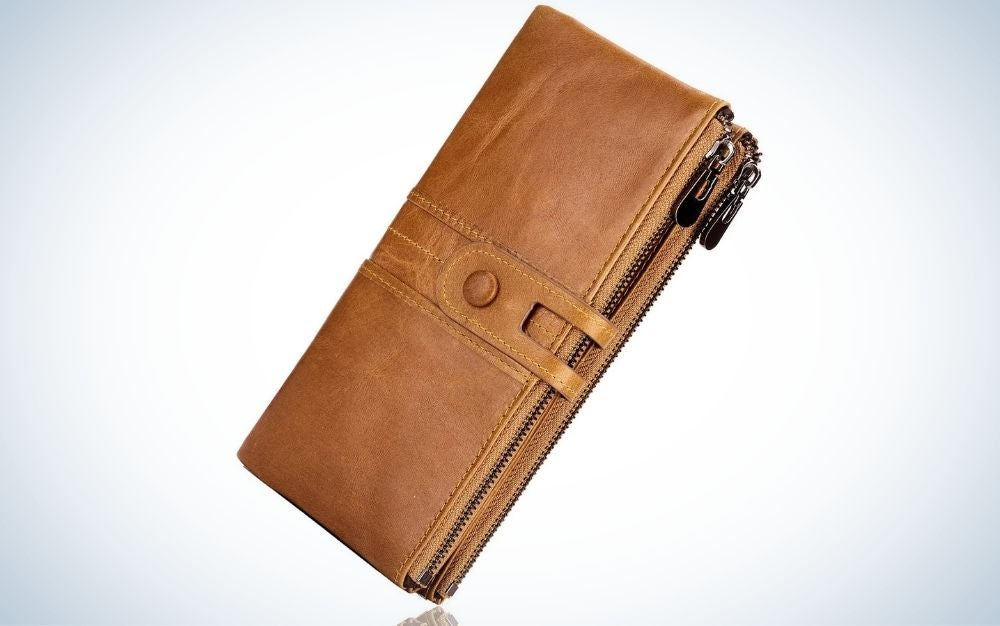 A rectangular women's wallet in brown all leather and with a clip to close it.