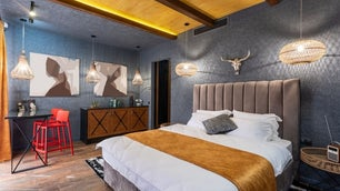 A very modern room with a design that is colorful and with some great lamps and lights.