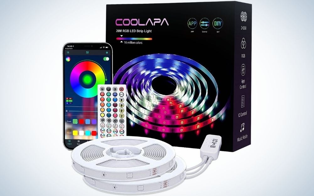 A black square box with the figure of blue and pink and purple lights, as well as a black smartphone with some applications in it and a remote control small some products in the form of spheres with chargers with plugs in it.