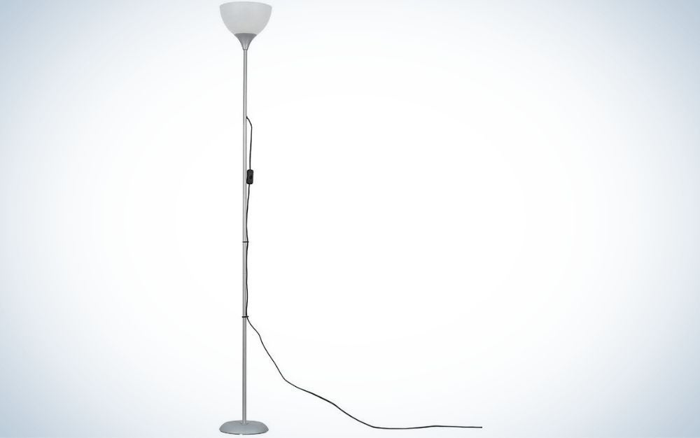 Modern silver, standing lamp with a white shade for living room